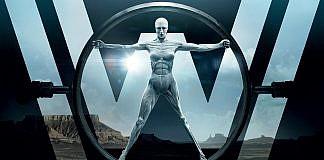 Imagem da série Westworld, da HBO. A imagem mostra um dos androides sendo construído, com um grande W ao fundo.