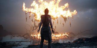 Imagem do jogo Hellblade: Senua's Sacrifice, da Ninja Theory, em que a protagonista feminina está de frente para uma árvore em chamas.