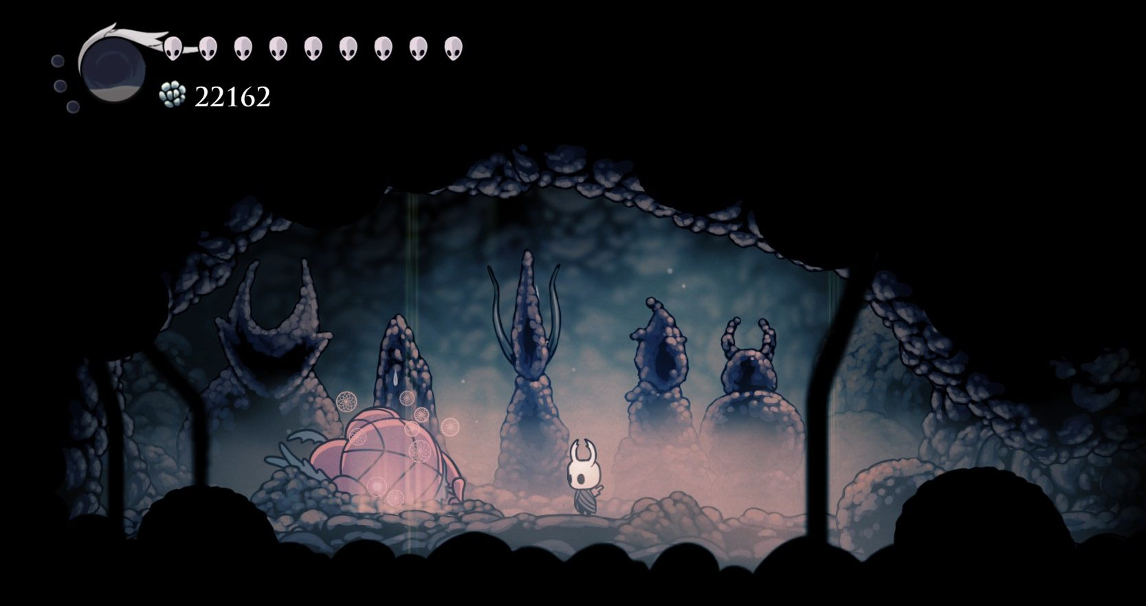 Imagem de Dung Defender dormindo em sala secreta de Hidden Dreams, DLC de Hollow Knight, Metroidvania da Team Cherry