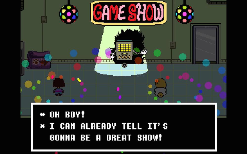 Imagem do jogo Undertale, de Toby Fox, que mostra o inimigo Mettaton sob um letreiro de programa de auditório.
