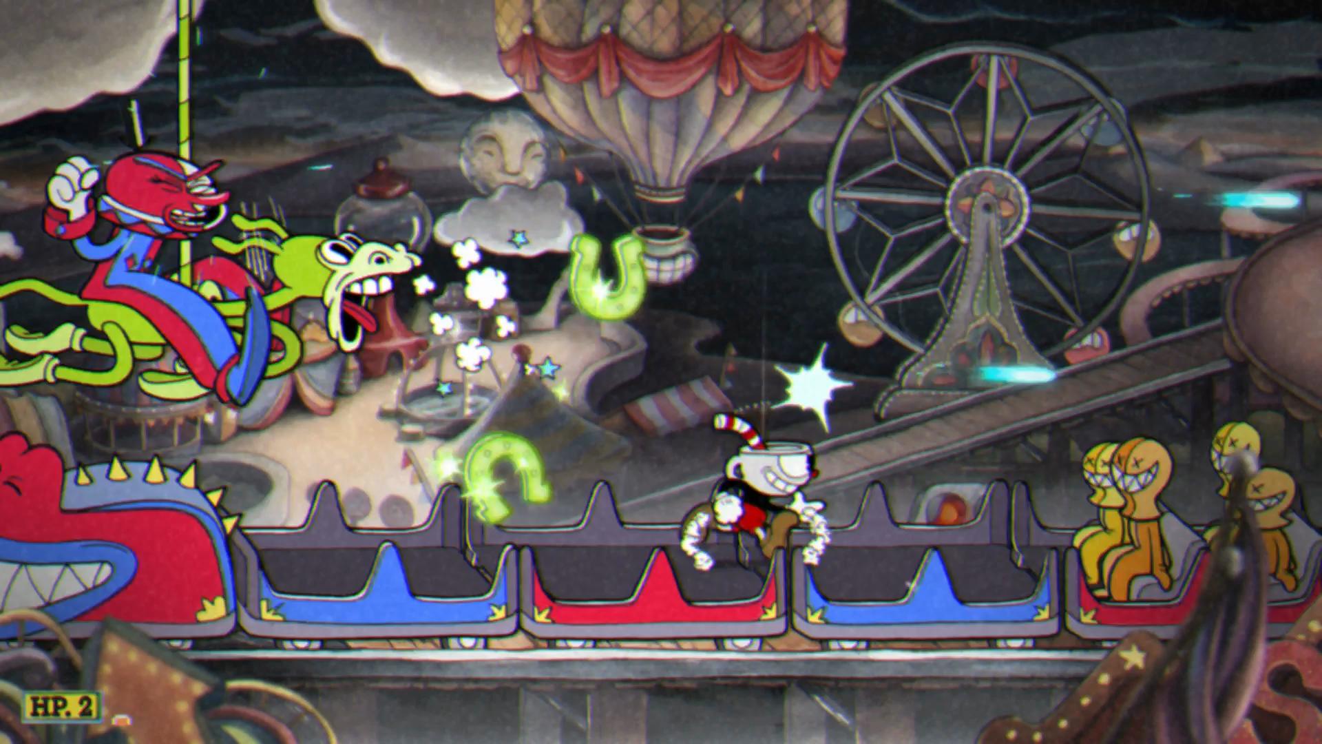 Imagem do jogo Cuphead: Don't Deal with the Devil, que mostra uma batalha de mestre contra o palhaço Beppi. O jogo é inspirado em desenhos animados das décadas de 20 e 30.
