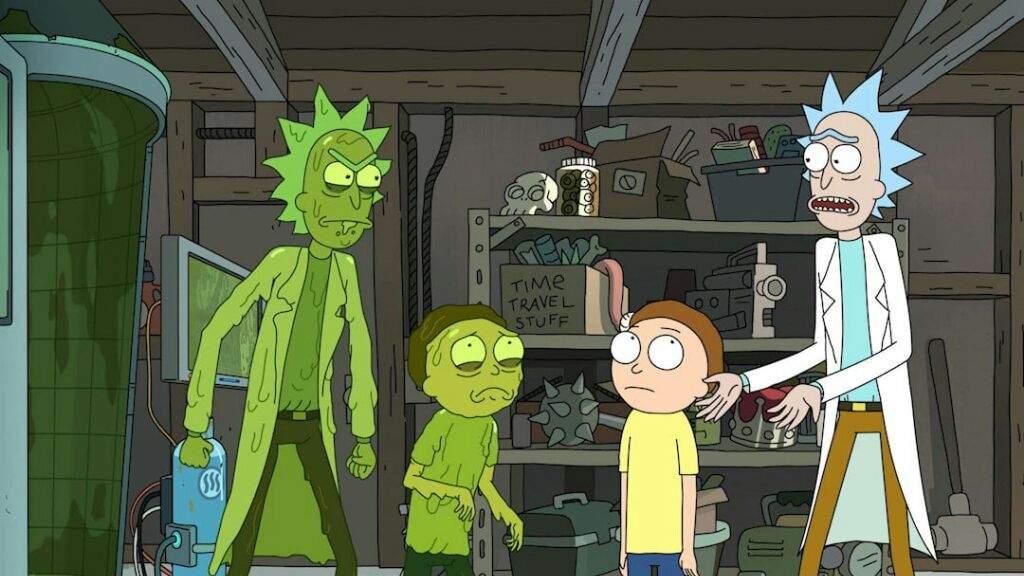 Imagem da série Rick and Morty, que mostra Rick e Morty confrontando suas versões tóxicas, que são verdes e gosmentas.