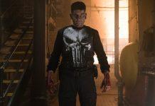 Imagem da série O Justiceiro, ou The Punisher, parte da parceria Marvel e Netflix. A imagem mostra Jon Bernthal vestido como o Justiceiro, e ensaguentado.