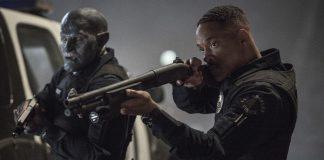 Imagem do filme Bright, da Netflix, estrelando Will Smith. a imagem mostra dois policiais, um humano e um orc. O humano porta uma arma.